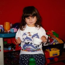 Julia as a child playing with toys
